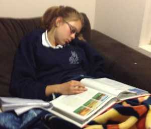 Julia falling asleep over homework