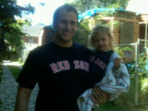 Daddy and daughter in Red Sox shirts