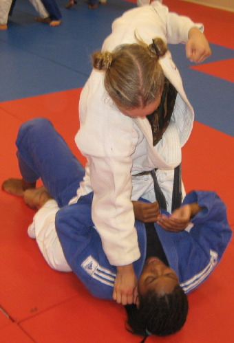 Ronda punching Crystal