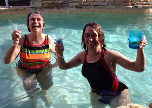 Me and my mom in a pool with martinis